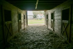 A shot from inside an old barn looking out. stock image