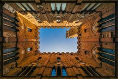 Siena palazzo pubblico seen from the inside against the sky stock images