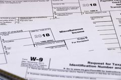 Shot of IRS tax forms 1099-M, 1099-K and W-9 stock photos