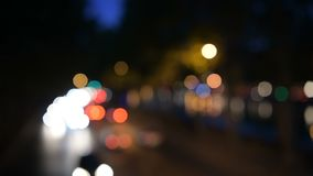 Night city street colorful lights bokeh background. Shot in 4k on a full frame dslr, suitable for commercial use stock video