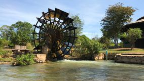 Water-wheels turbine rotating in the garden stock footage