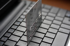 A shot of a laptop and a credit card Stock Photos