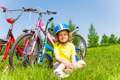 Shot of a little girl with bicycles Royalty Free Stock Image