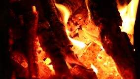 Fireplace. Shot of logs burning in fireplace flame in detail stock footage