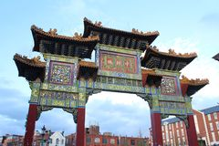 Arch at the entrance to Chinatown, Liverpool, Merseyside. A shot looking up to the arch or pairing on Nelson Street in Liverpool`s Chinatown Stock Image