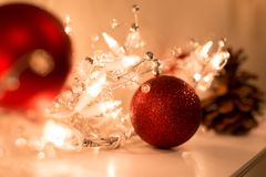 Shot in low light with high ISO Christmas ball with christmas li. Ghts decoration on top of fire place Royalty Free Stock Image