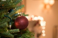 Shot in low light with high ISO Christmas ball hanging on the ch. Ristmas tree with light Royalty Free Stock Photography