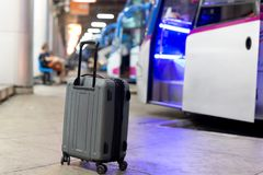 Shot in low light suitcase on a busy train station. In blur background Royalty Free Stock Photography