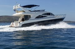 Luxury motor yacht at full speed. Shot of a luxury motor yacht cruising at full speed Royalty Free Stock Photos