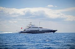 Luxury motor yacht cruising the sea royalty free stock image