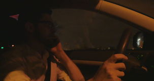 Shot of man driving at night stock video footage