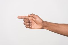 Shot of man hand pointing with finger. Royalty Free Stock Images