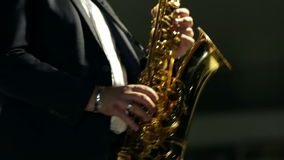 Shot of man intensely playing saxophone stock video footage