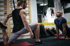 Two men`s working out in the gym. A shot of men`s working out in the gym. Two male in gym Royalty Free Stock Images