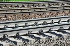 Metals on rail track. Shot of metals and sleeper on rail road track Royalty Free Stock Image