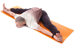 Shot of middle aged man practicing yoga on mat Royalty Free Stock Images