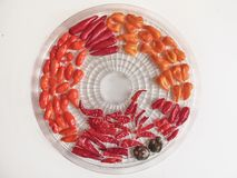 Shot of a mix of red, orange, yellow and black peppers stock image