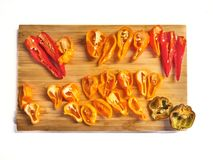 Shot of a mix of red, orange, yellow and black peppers stock images