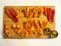 Shot of a mix of red, orange, yellow and black peppers royalty free stock photos