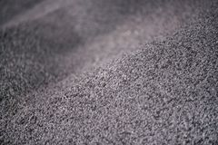 Shot of mixed chemical, artificial nitrogen plant fertilizer granules in factory. Big heaps of mineral pellets creating abstract textures, patterns. Minerals royalty free stock photo