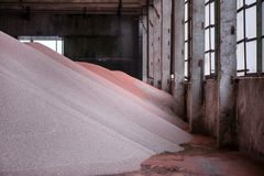 Shot of mixed chemical, artificial nitrogen plant fertilizer granules in factory. Big heaps of mineral pellets creating abstract textures, patterns. Minerals stock photo