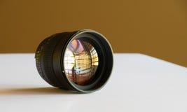 Shot of 85mm DSLR Lens. Clean image of colorful 85mm DSLR lens looking back at the camera Stock Image