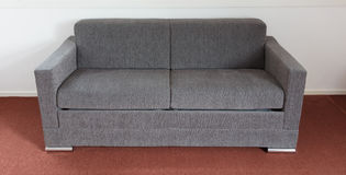 Shot of a modern couch. In a living room Stock Photography