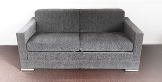 Shot of a modern couch. In a living room Royalty Free Stock Images