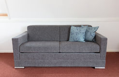 Shot of a modern couch. In a living room Stock Photo