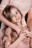 Shot of mother hugging adorable little daughter Royalty Free Stock Images