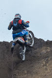 A shot of a motocross rider during a race Royalty Free Stock Image