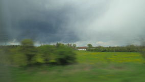 Shot of moving countryside landscape from window of train, Vienna, Austria stock video