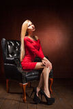 Shot Of Beautiful Woman Wearing Red Dress Sitting Royalty Free Stock Image