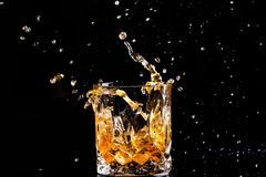 Free Shot Of Whiskey With Splash On Black Background, Brandy In A Glass Royalty Free Stock Images - 148357289