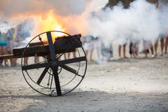 Shot from an old gun powder burning fire and clouds of smoke Stock Image