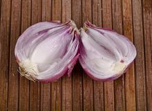 An onion split in two royalty free stock photography
