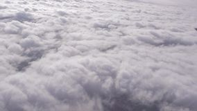 Shot out of an airplane window of dense cloud. Video of shot out of an airplane window of dense cloud stock footage
