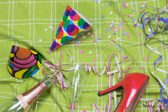 Shot of after party mess wth red court shoe Stock Photo