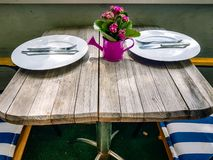 Patio furniture set out for a traditional german breakfast on balcony royalty free stock photography