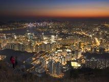 Shot at Peak. A girl wear red coat shot photo at Kowloon Peak Fei Ngo Shan Royalty Free Stock Images