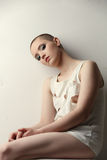 Shot of pretty skinhead girl in ragged t-shirt Stock Image