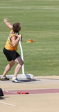 Shot Put. An athlete performing in the shot put event Royalty Free Stock Photography