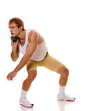 Shot Put. Track and field athlete competing in shot put. Studio shot over white Stock Photography
