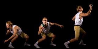 Shot Put. Athlete. Studio shot over black Royalty Free Stock Photos
