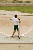 Shot put 3. A competitor in the men's shot put event during a college track meet Stock Image