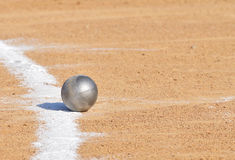 Shot Put by Chalk Line. On Dirt Royalty Free Stock Image