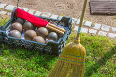 Shot put in detail. Shot put spheres and red flag with broom in athletics Stock Images