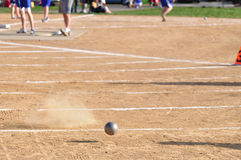 Shot Put Landing on Dirt Royalty Free Stock Photos