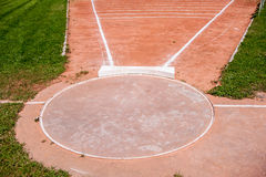 Shot put ring. And field with chalk lines Royalty Free Stock Photos