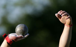 Shot put, two male hands Royalty Free Stock Photography